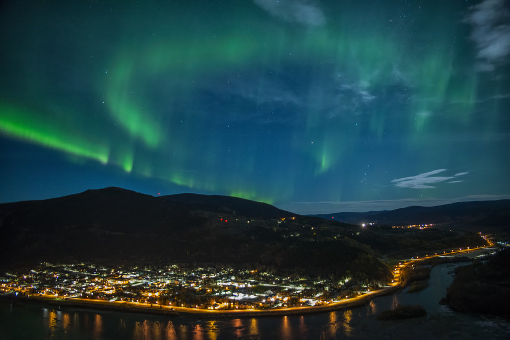Aurora over Dawson City Yukon by Chris Pepper