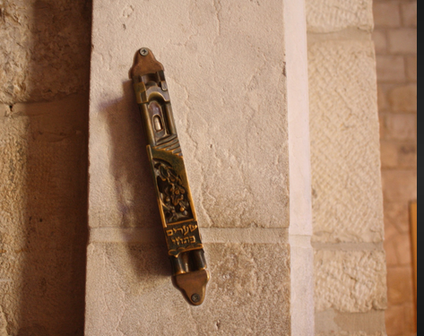 A Mezuzah on a doorpost in Israel. It contains the Shema on it.