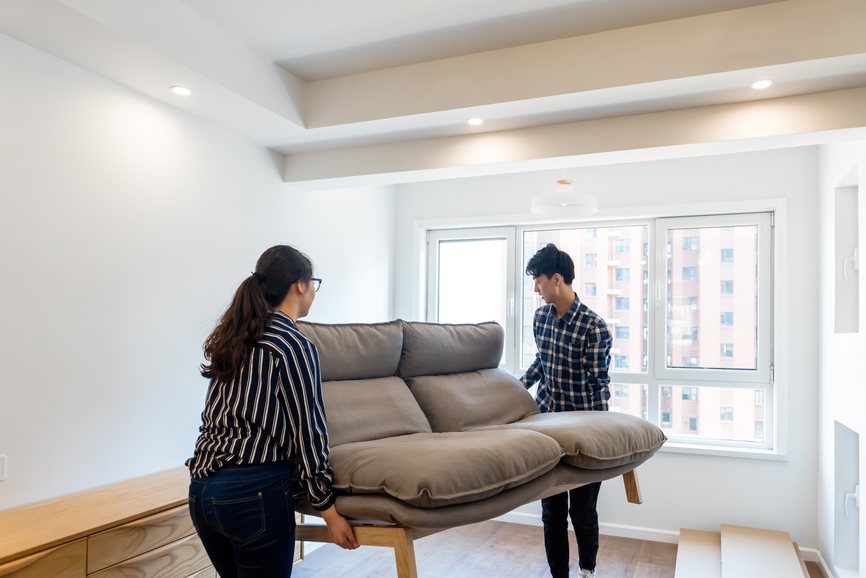 OWN Stocksy Wedding BuyersAgent.com couple moving couch.jpg