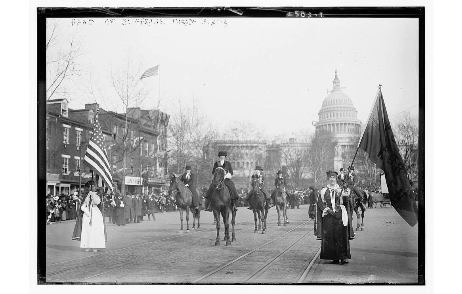 Grand Marshal Mrs. Richard Coke Burleson (center, on horseback) leading suffrage march on March 3, 1913.