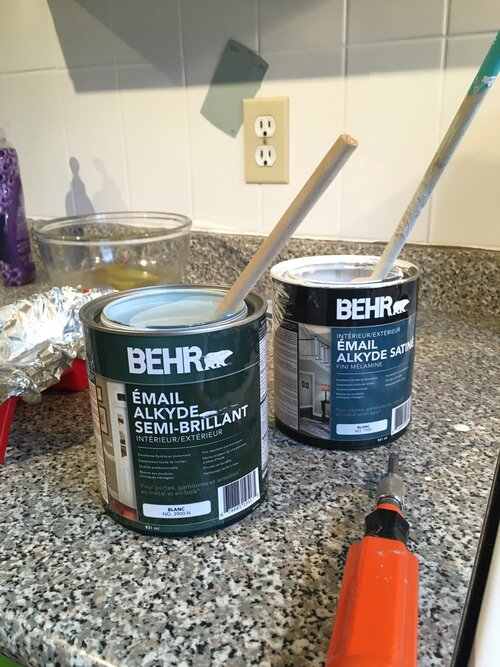 The can on the right is the Behr Alkyd Semi Gloss in Watery - the can on the left is the left over Behr Alkyd Satin Melamine Finish in White that was left over from the tile project.