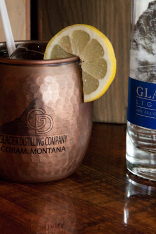Montana Mule -  In a copper mug:Muddle one lemon wedgeAdd iceAdd 1 oz. Glacier DewTop with ginger beer (we use Glacier Ginger, made in Whitefish, MT and otherwise recommend Cock'n Bull brand)