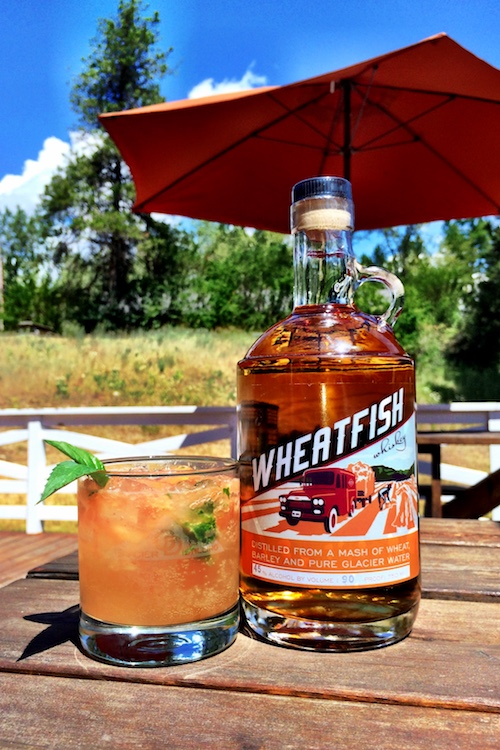 Wheatfish Whiskey Cocktail - Indian PaintbrushIn a shaker:Add iceAdd 1 oz.WheatfishAdd 2-4 mint leavesAdd 1/2 oz.simple syrupSqueeze one wedge of grapefruit and drop into shakerShake and pour into rocks glassAdd a dash of bittersTop with soda water
