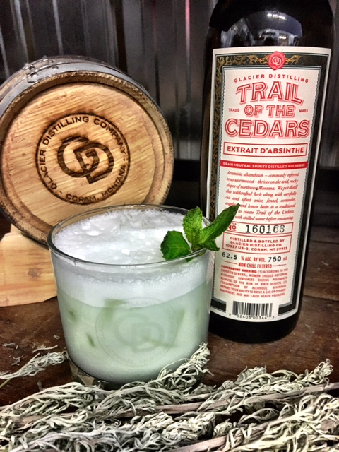 Enchanted Forest  (Absinthe Frappe) -  In a shaker:1 oz. Trail of the Cedars Absinthe1 oz. water1 oz. mint simple2 oz. half & halfSmall scoop of iceShake until ice is almost completely dissolvedDump into rocks glass filled with iceGarnish with spanked mintTo make mint simple: In a pot, dissolve 2 ½ cups sugar with 2 ½ cups water. Bring to a boil. Turn off heat. Add 4 oz. fresh mint. Let steep for 30 minutes. Strain and cool for serving. (For this cocktail, we like to add a little green food coloring to the simple, after straining.)