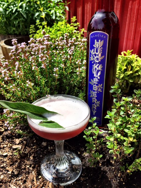 Huck Gin Fizz - In a shaker:1 1/2 oz. Huckleberry Gin½ oz. Agave Nectar½ oz. Egg WhiteFresh lemon wedge, squeezedDry shake for 30 seconds to emulsify Add ice and shake againStrain into martini glassGarnish with spanked sage