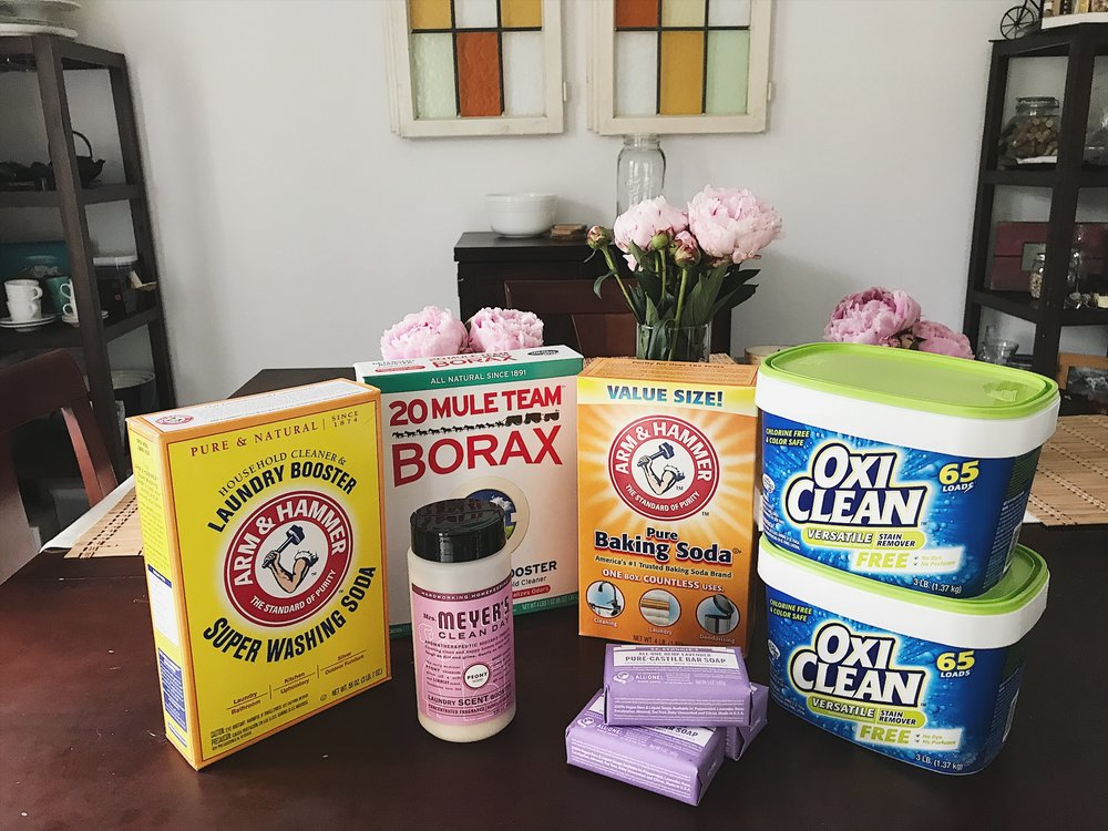 Step 1 - Purchase all ingredients for the laundry detergent. 3 bars of Dr. Bronner's castille bar soap, large box of baking soda, box of washing soda, box of Borax, two tubs of Oxi Clean, and (optional) Mrs. Meyer's Scent Booster. I'm able to purchase most of the items from my local grocery store and supplement with a few items from Vitacost.