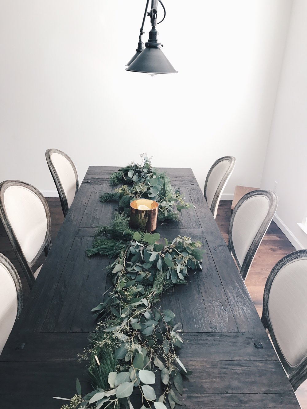 I grabbed their pine garland for $8.99 each and a few packs of eucalyptus for $2.99 each. BOOM- tablescape complete!