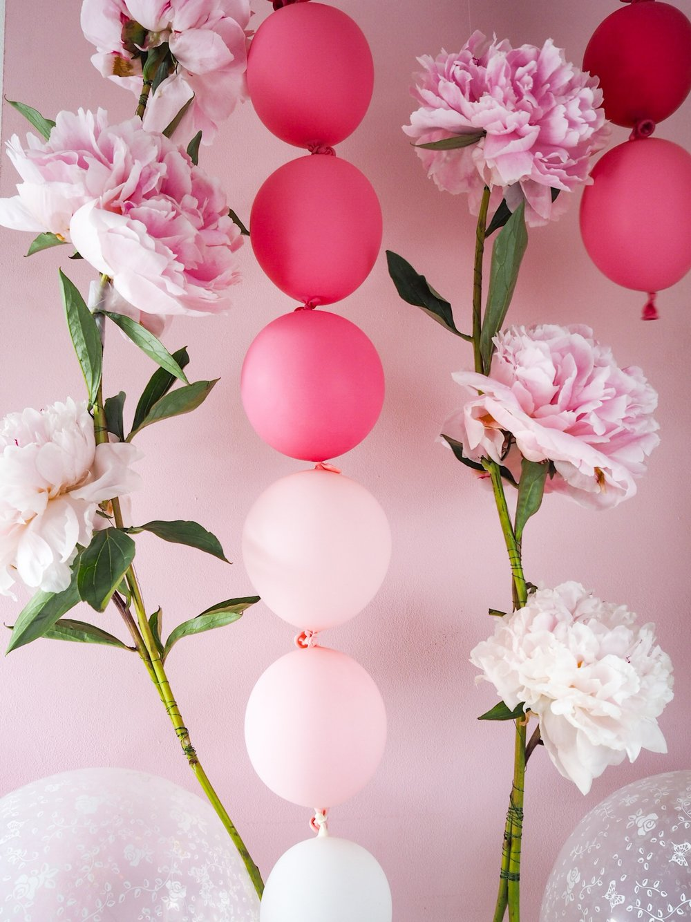 Why not try hanging them vertically for a fun backdrop. Here I used our pink ombré garland with some gorgeous peonies to make a super pretty display.