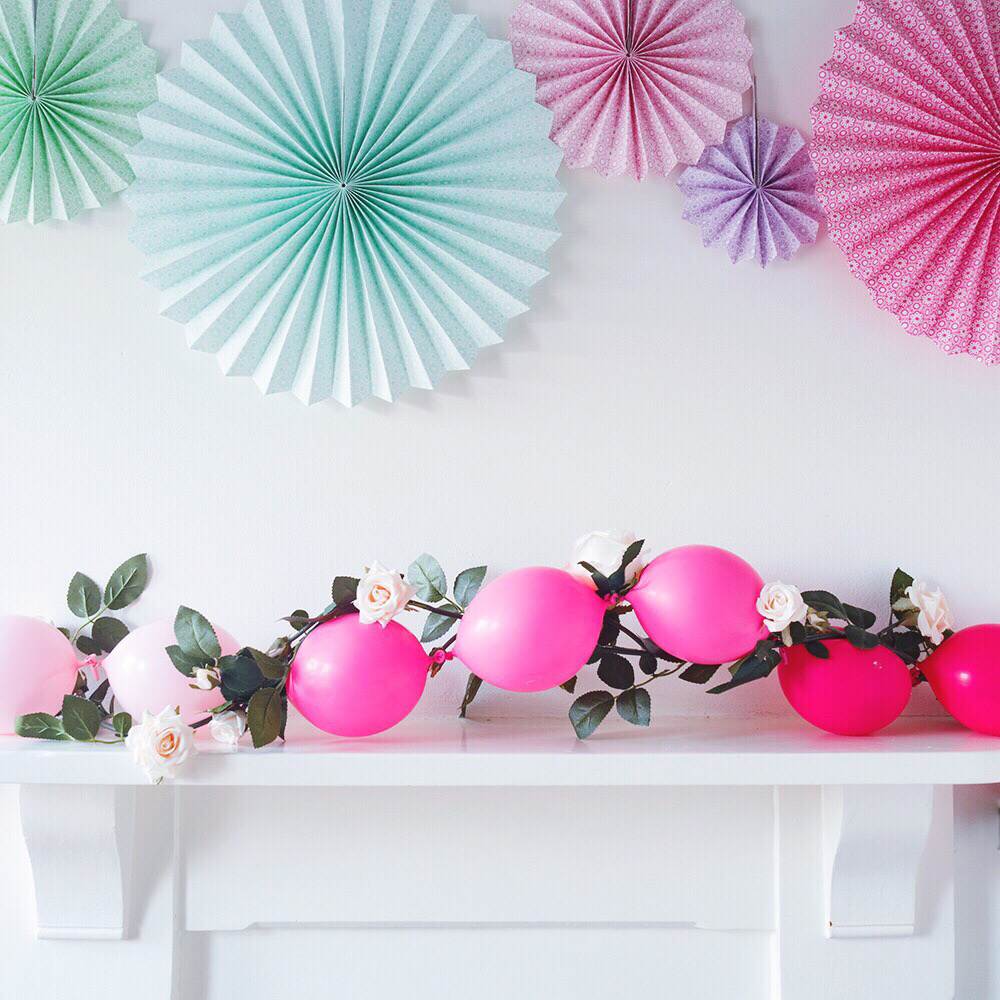 You could also wrap a faux flower garland with the balloon garland for more prettiness