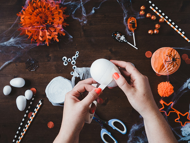 How to make a cute ghost halloween balloon tail - apply double sided tape to the polystyrene egg.