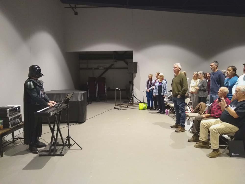 Tony Lechner as Darth Vader conducts a rehearsal of Rock Voices at its weekly rehearsal in the Flex. Tony is the founder and creative director of  Rock Voices , Inc.