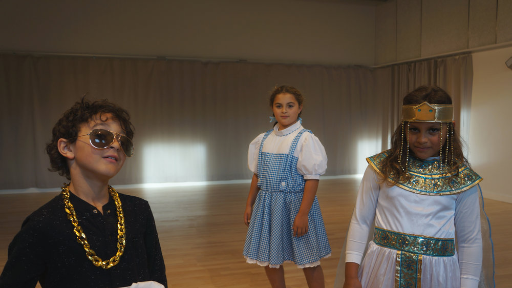 Playing the Museum Director game during Kelly Silliman's Youth Modern Jazz class on Halloween Night. The Fisher kids showed up to the class in costume: Julian as Bruno Mars, Kaiulani as Dorothy (sans Toto), and Kalea as Cleopatra.