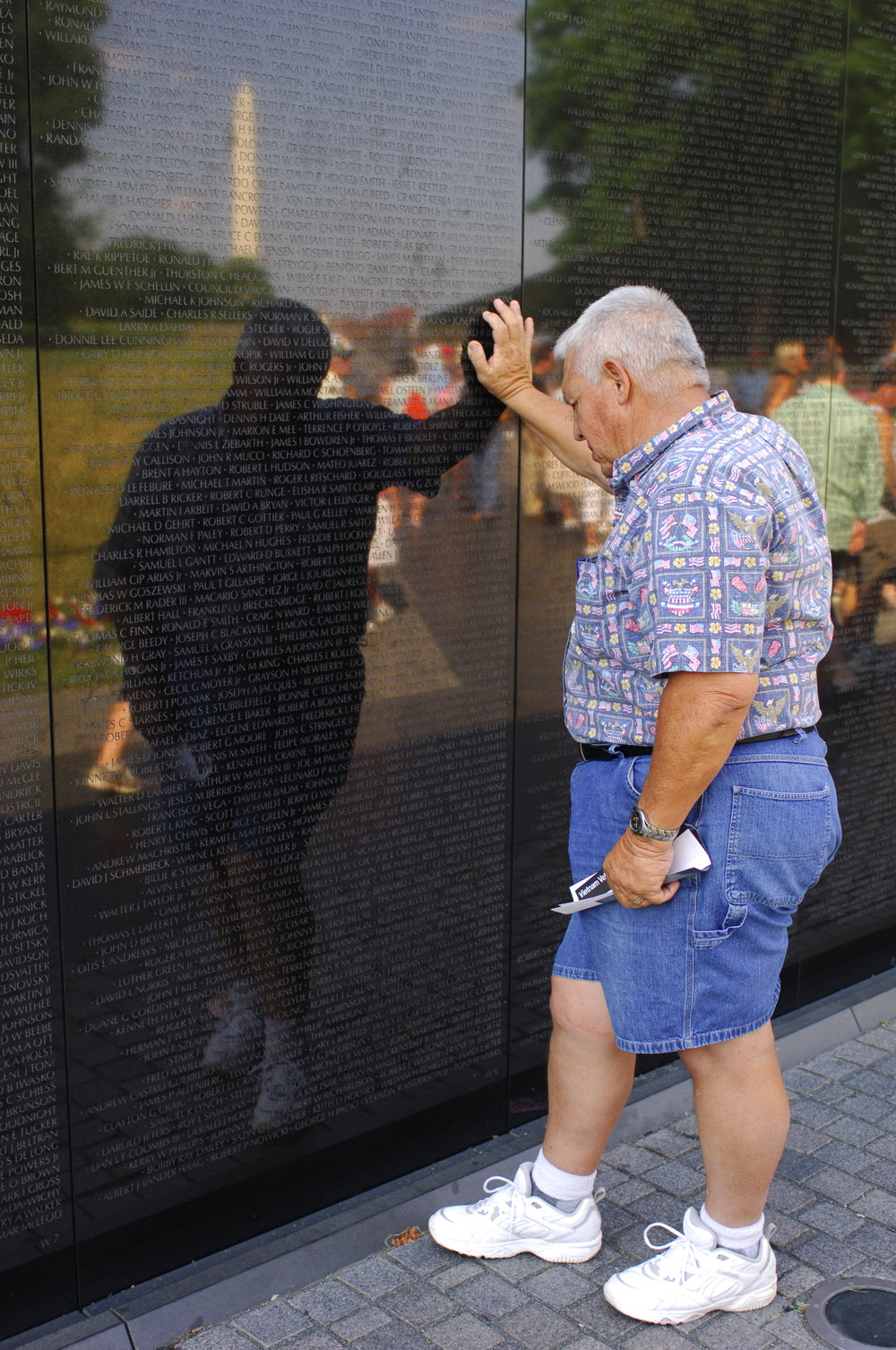 """I took my dad to see The Wall for the first time about 10 years ago and I snapped this photo. This man, my father, fought for this country, and he bears the scars to prove it. When he came home, he continued to give - paid his taxes, worked his ass off - and the Department of Veterans Affairs rewarded him by cutting his benefits. That's how our government """"supports the troops."""""""