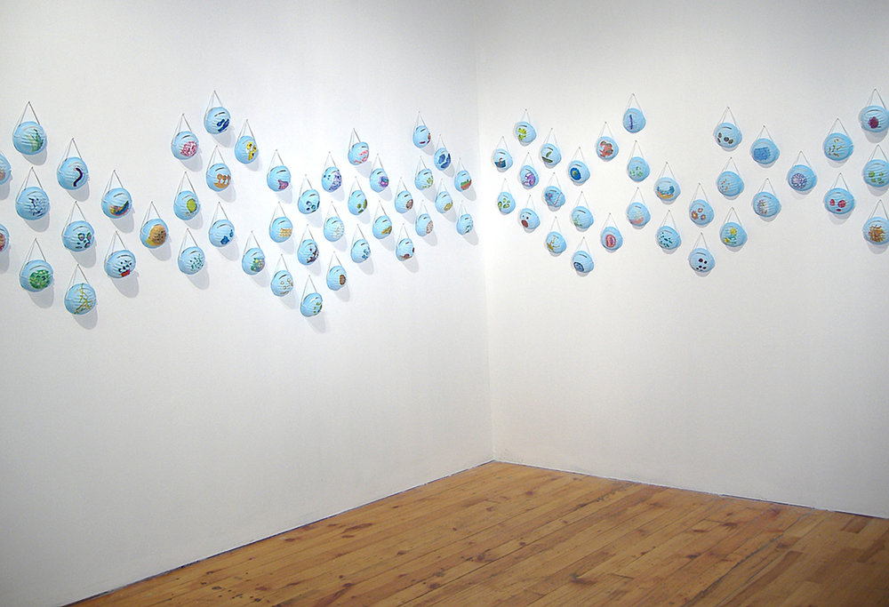 "Miasma Gouache and 123 respiratory masks 27' x 4' x 3""  2006"