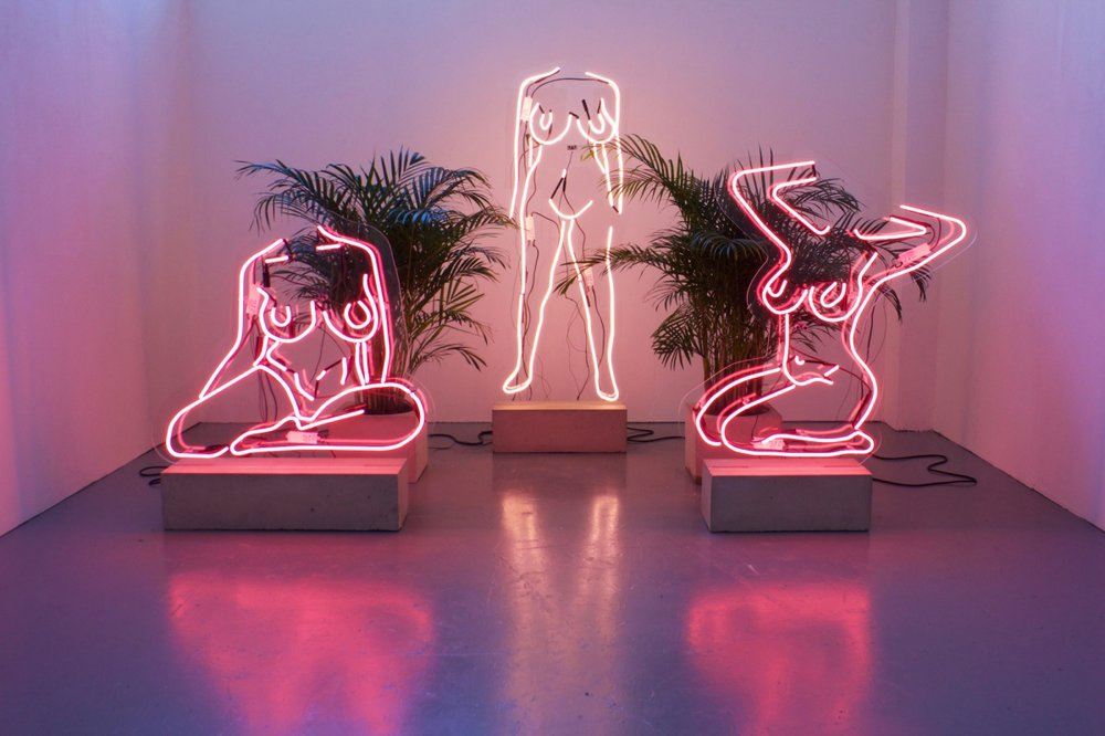 Romily Alice Walden's stunning female nudes in neon light sculptures