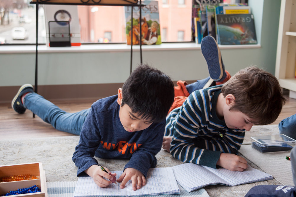 Literacy and Math in mixed-age classes allow for self-paced learning with guidance from teachers and peer support.
