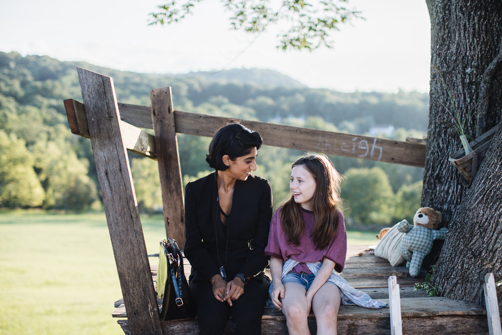 Lead actress Sunita Mani ( Glow ) shares a heartfelt moment with co-star Audrey Bennett (Broadway's  Frozen ) on set of the newest Moving Picture Institute original short film,  Regulation.