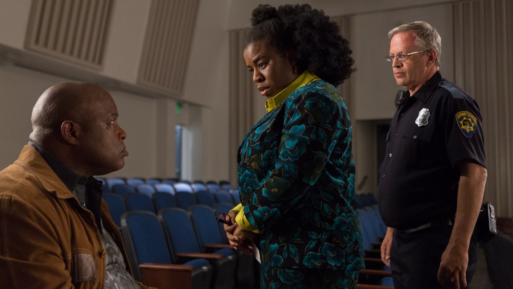 Virginia (Uzo Aduba) commiserates with a fellow concerned parent at a town hall meeting.