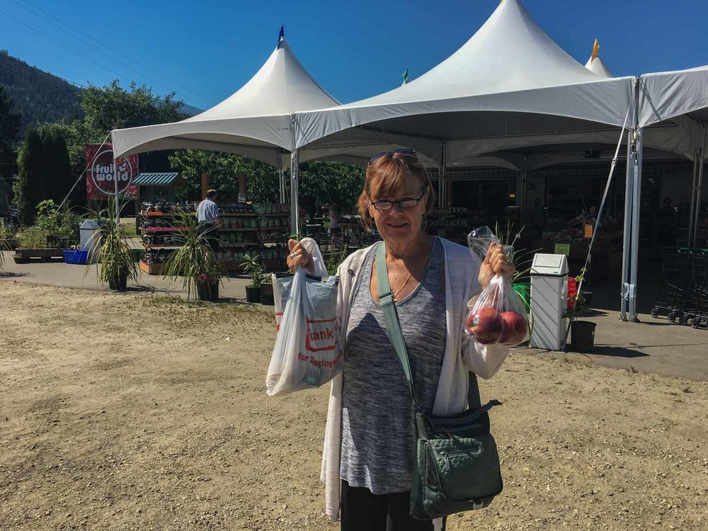 Carol with the goodies from fruit world