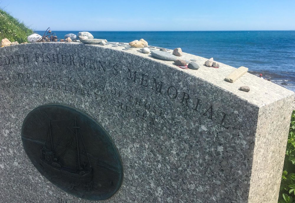 The Fishermen's Memorial overlooking the sea.