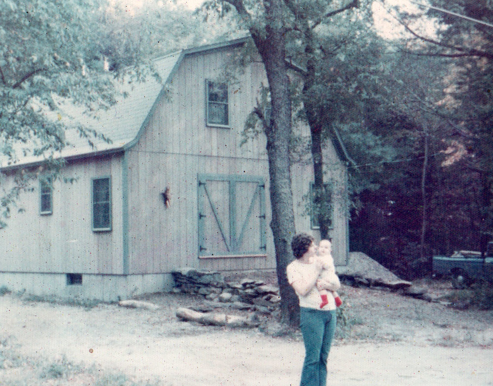 Carol holding Megan just around the time we moved in, 1975