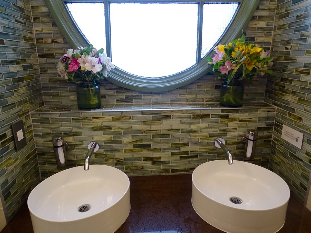 The women's bathroom; fresh flowers are delivered every Monday.