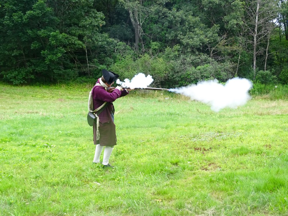 A musket firing demonstration on the Whittemore House property.