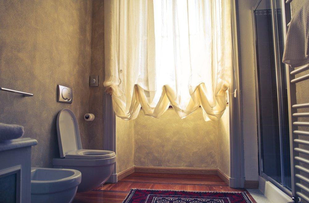 Pexels: This bathroom has a toilet and bidet.