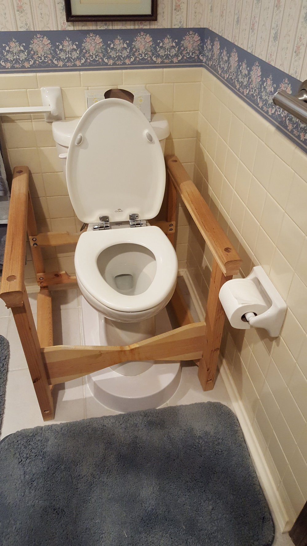 After - We installed a Toilevator to make the toilet seat 20 1/2 inches from the floor and kept the wooden armrests. My client was ecstatic!