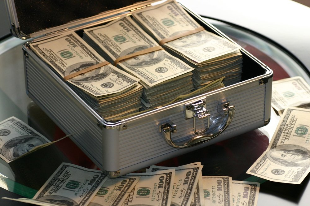 Briefcase full of money. Photo by Pexels