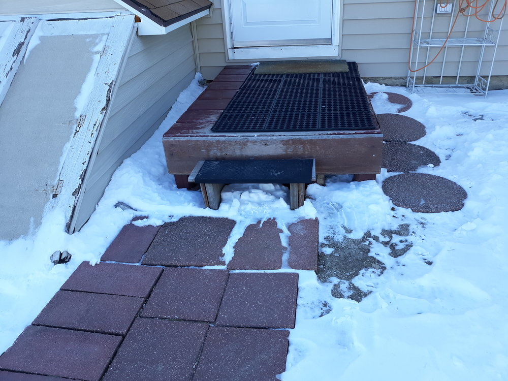 This is my back stoop with uneven pavers and rubber mats! This is a work in process, my darlings!