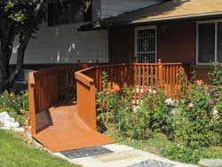 Wooden ramp from driveway to front door. Photo by Wheelchair Special Needs Project.