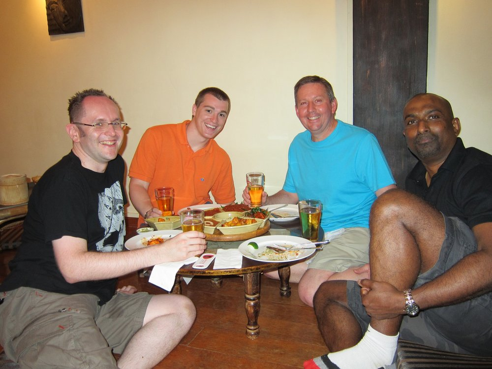 A Brit, American, Australian and Sri Lankan eating Indian food in Singapore.  Singapore, Singapore - 2011