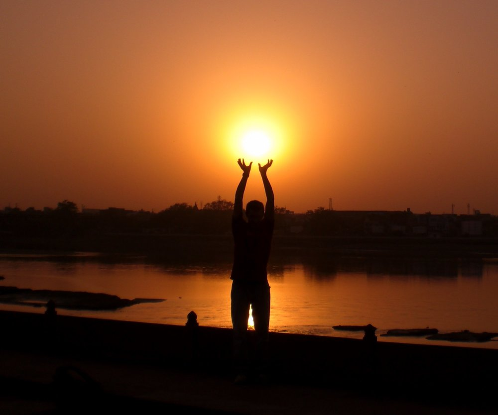 Getting creative with the camera as the sun sets on the banks of the Yamuna River.  Agra, India - 2008