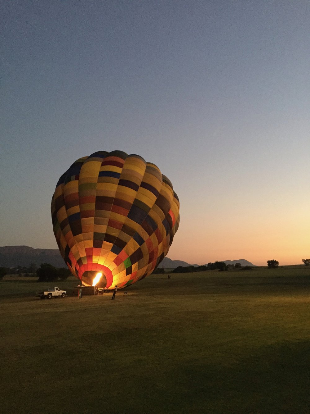 Prepping for an early morning hot air ballon ride over the Magaliesberg mountains.   Magaliesberg, South Africa - 2016