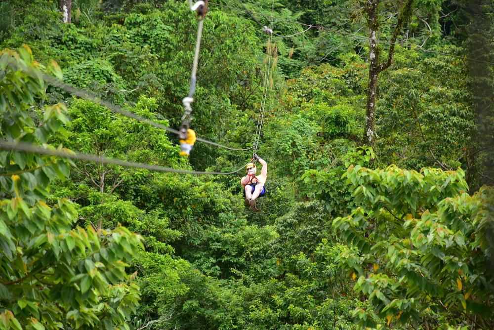 Zip-lining through the rainforest at the foot of Arenal Volcano.  La Fortuna, Costa Rica - 2017