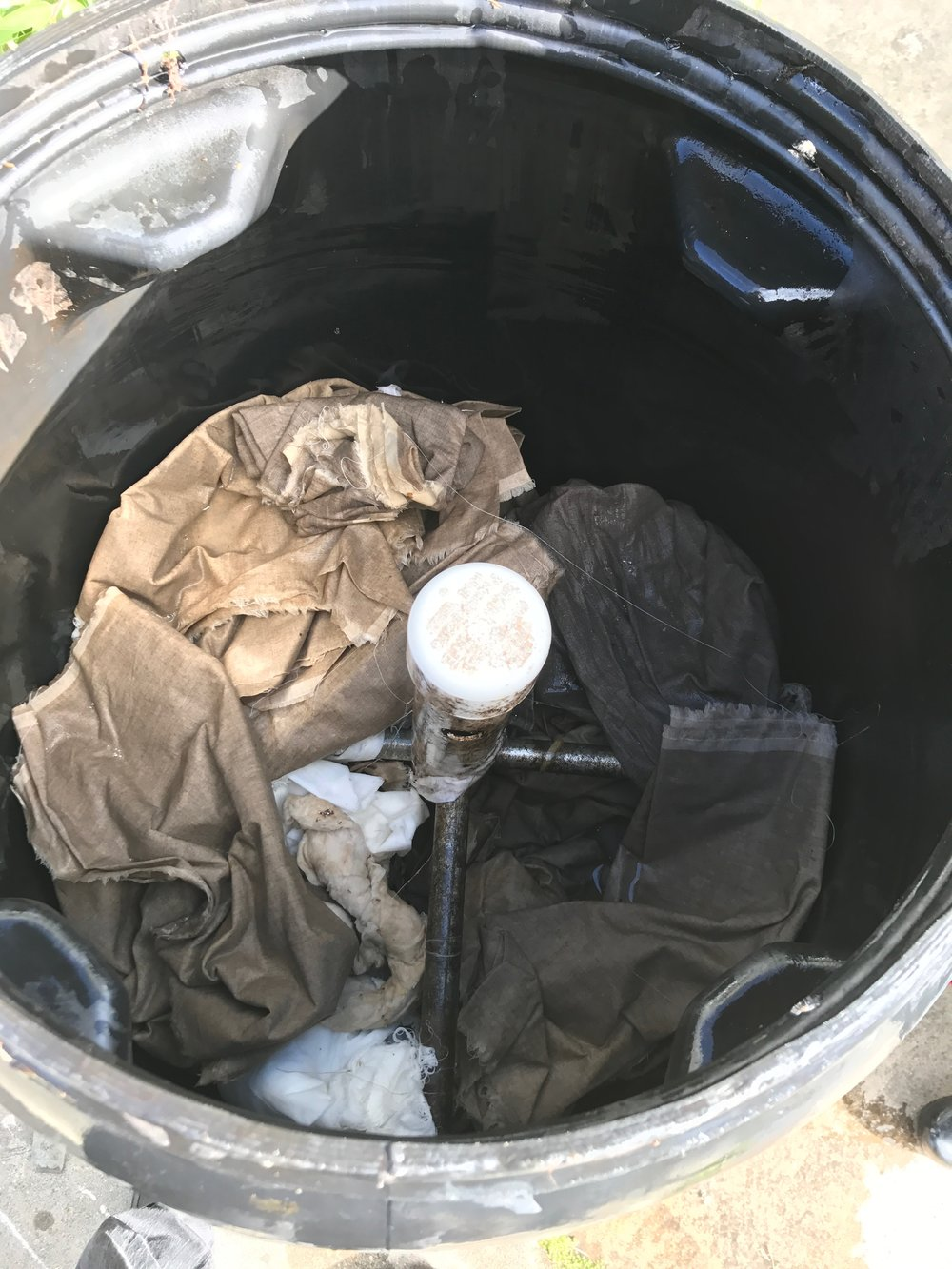 Rags retting in compost bin
