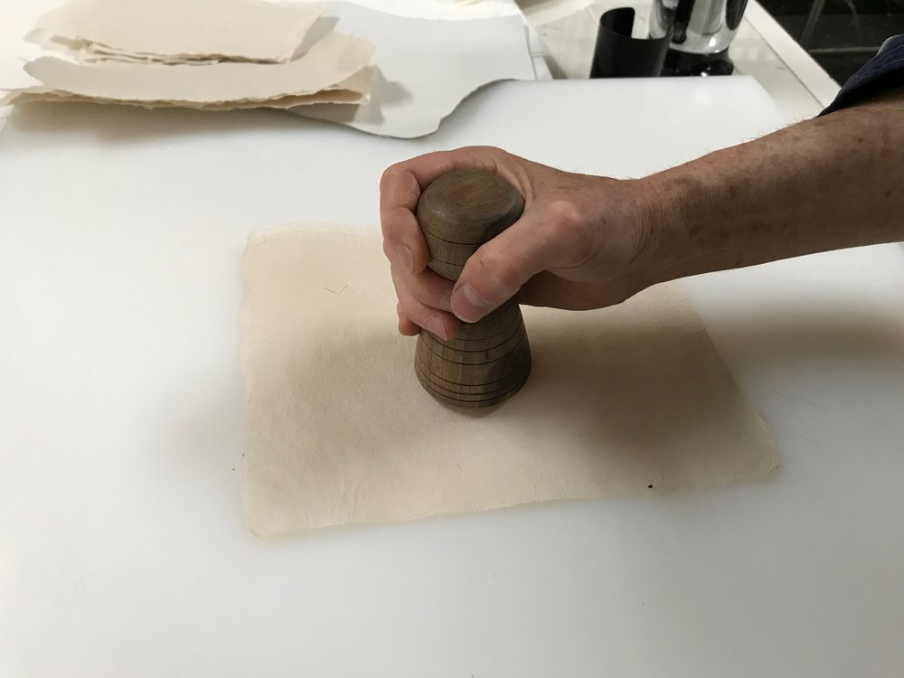 Burnishing a sheet by hand