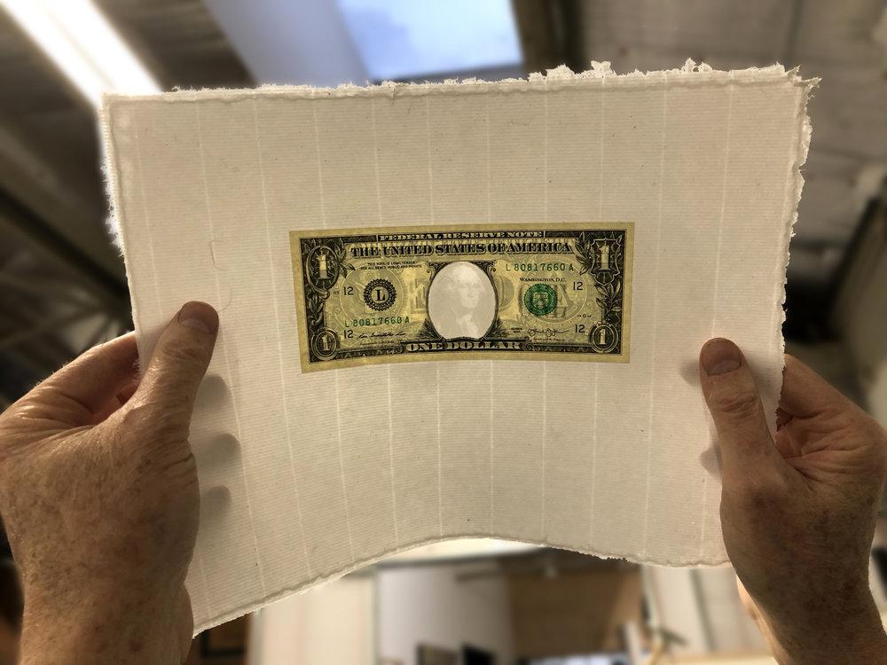 Holding dollar watermark to lightIMG_8308.jpg