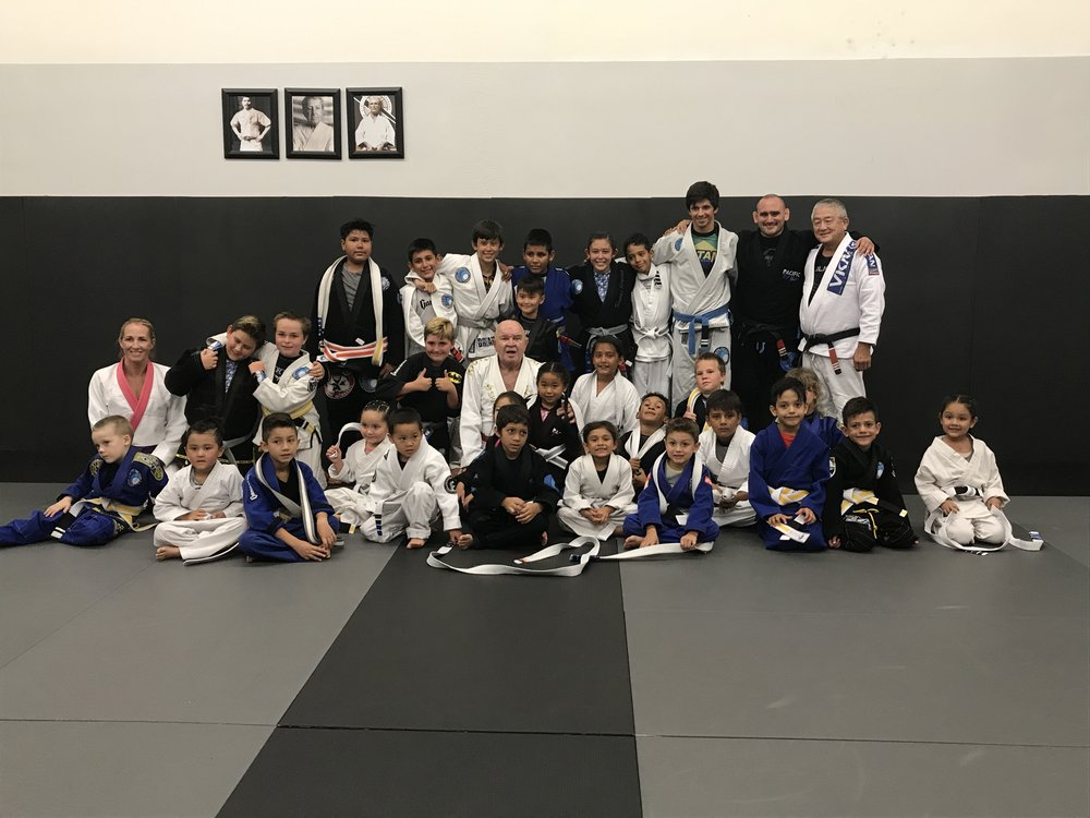 Kids received their Belts from Jiu Jitsu Legend 9th Degree Red Belt GranMaster Francisco Mansor