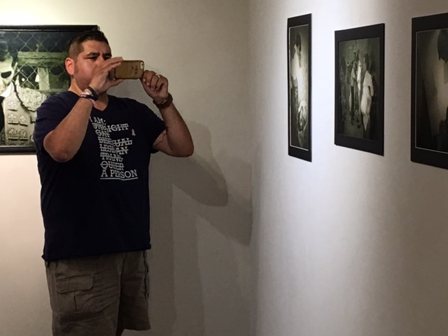 Ruben-photographing-his-exhibition-10-20-16.JPG