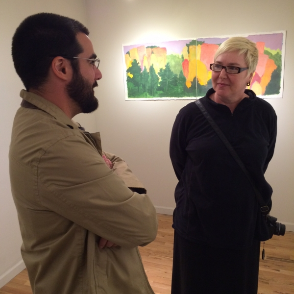Felipe speaking with Cathryn Hugger at Opening, 11-21-14