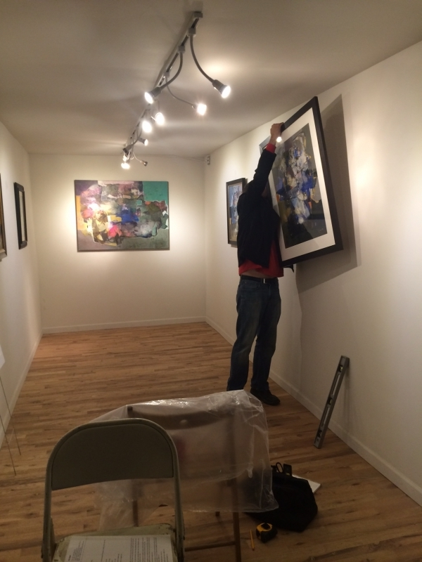 Brent Bond installing Falah's Onloaded solo exhibition, 12-18-14