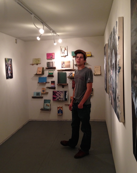 Ben Peck with his installed art exhibit, 2-19-15  Photo credit: Alexis Duque