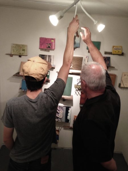 It takes two! Ben Peck and Ted Decker adjusting the lighting, 2-19-15  Photo credit: Alexis Duque