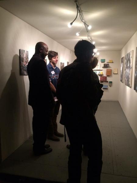 People enjoying Ben's exhibit on opening night, 2-20-15