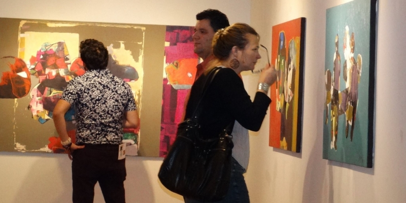 Art patrons enjoying Najelaa's paintings. Third Friday, 3-20-15. photo credit - Falah Alsaidi
