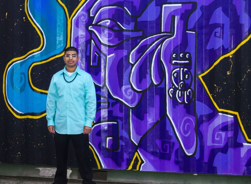 Edgar standing in front of the mural he painted, Third Friday, 10-16-15. Photo credit - Tania Ritko