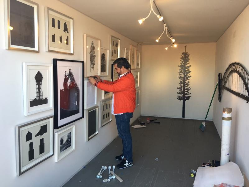 Daniel installing his exhibit, 12-15