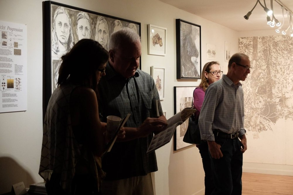 Viewers at Carolyn Lavender's exhibition, 3-18-16. Photo credit Salman Alwastey.  Photo credit: Ted Decker